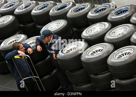 Mechanics chat in the racing tyres at the paddock of the Nuerburgring race track in Nuerburg, Germany, Thursday - Stock Photo