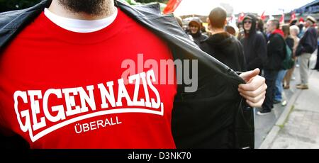 A man shows his T-Shirt reading 'Gegen Nazis - Ueberall' (Against Nazis - Everywhere) during a demonstration against - Stock Photo