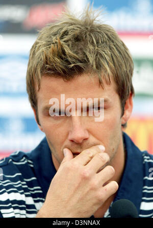 English national soccer team captain David Beckham thoughtfully answers questions of journalists during a press - Stock Photo