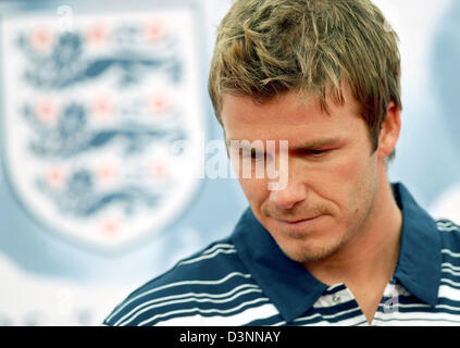 English national soccer team captain David Beckham waits for questions of journalists during a press conference - Stock Photo
