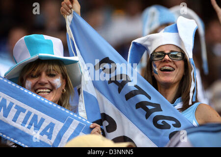 Argentinian supporters cheer prior to the 2006 FIFA World Cup group C match of Argentina vs Ivory Coast in Hamburg, - Stock Photo