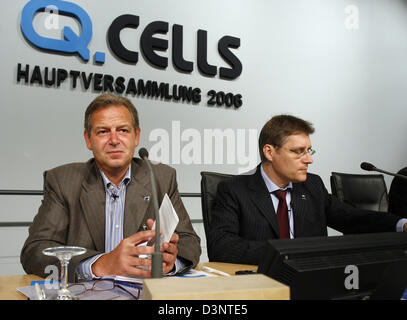 Chairman of the solar cell producing company Q-Cells, Anton Milner (L) and finance board Hartmut Schuening sit during - Stock Photo