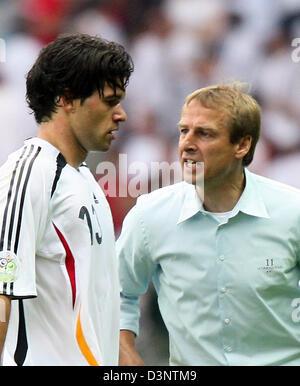 Germany's team captain Michael Ballack (L) receives instructions by coach Juergen Klinsmann during the quarter final - Stock Photo