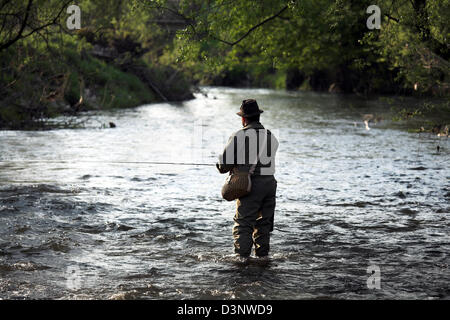 a flyfisher stands in the White Main trying to catch trout near Koednitz, Germany, Thursday, 18 May 2006. The White - Stock Photo