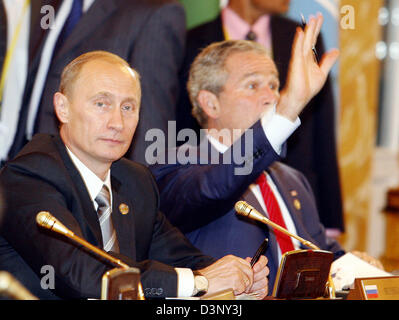 US President George W. Bush (R) sits next to Russian President Vladimir Putin at the conference table in the Marble - Stock Photo