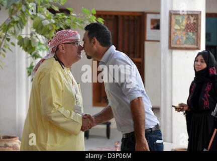 Arab men greeting each other stock photo 15903717 alamy two arab men greeting each other they are familiar they rub their noses together m4hsunfo
