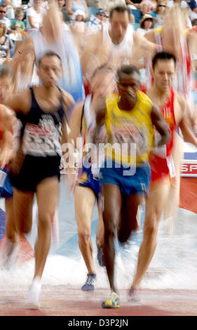 Participants of the men's 3000 metres steeplechase run through a water ditch during a heat at the 2006 European - Stock Photo