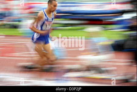 Participant of the men's 3000 metres steeplechase, French Bouabdellah Tahri runs through a water ditch during a - Stock Photo