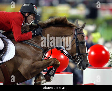 The picture shows German rider Ludger Beerbaum and his horse 'L'Espoir' during the team jumping competition at the - Stock Photo