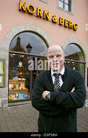 Thomas Kistner, owner of the book shop Korn & Berg, poses in front of his store in Nuremberg, Germany, Tuesday 15August - Stock Photo