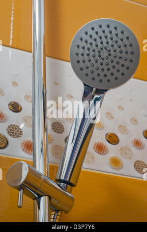 New shower head in the corner of the shower. - Stock Photo