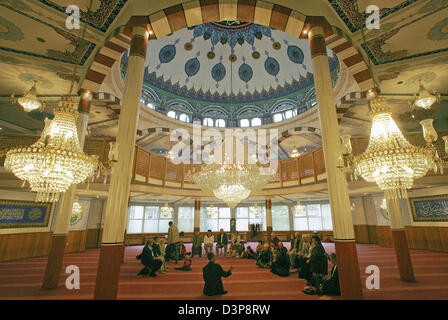 Interior of the yavuz selim mosque in istanbulturkey stock photo visitors sit on the floor in the scope of the 10th open mosque event thecheapjerseys Images
