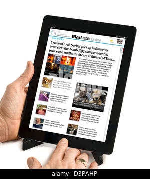 Using the Daily Mail app to read the Mail Online newspaper on a 4th Generation iPad, UK - Stock Photo