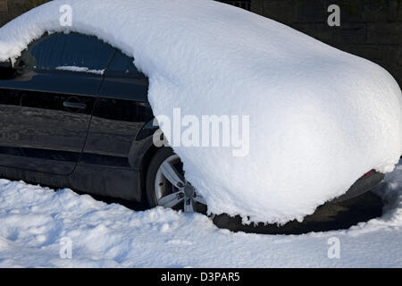 Parked car covered in a blanket of snow York North Yorkshire England UK United Kingdom GB Great Britain - Stock Photo