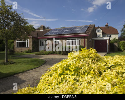 array of 16 solar panels on bungalow - Stock Photo