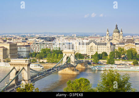 Chain Bridge over the river Danube with the Gresham hotel, St Stephen's basilica, cruise boats Budapest, Hungary, - Stock Photo