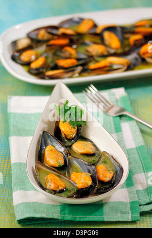 Mussels with herbs. Recipe available. - Stock Photo