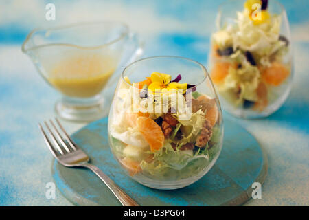Escarole salad with tangerines. Recipe available. - Stock Photo