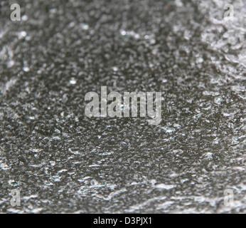 An ice covered windshield looking from the inside out - Stock Photo