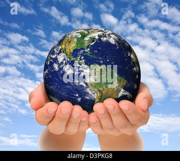 Woman holding globe on her hands, South and North America. - Stock Photo