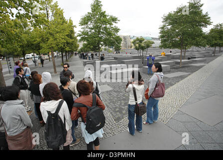 Berlin, Germany, Asian tourists in front of the Monument to the Murdered Jews of Europe - Stock Photo