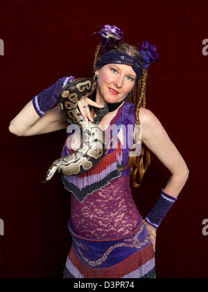 Portrait of a woman holding a snake - Stock Photo