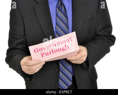 Government employee receiving furlough notice - Stock Photo