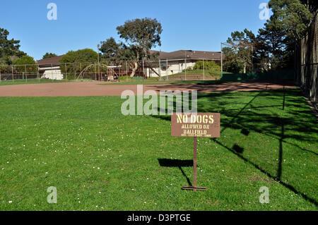 No Dogs allowed sign on Glen Park baseball field - Stock Photo