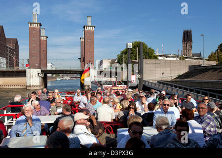 Duisburg, Germany, tourists at a harbor cruise - Stock Photo