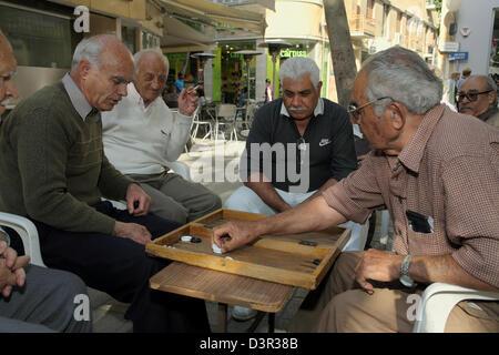 Nicosia, Cyprus, men playing backgammon in einerm Street Cafe - Stock Photo
