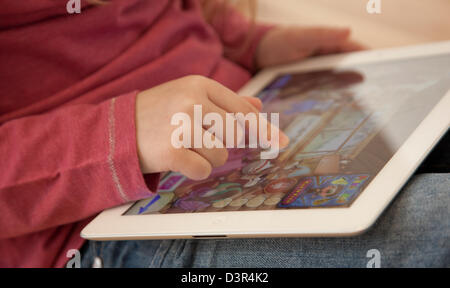 Young girl playing on an apple iPad tablet computer