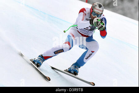 Garmisch-Partenkirchen, Germany. 23rd February 2013. Swiss skier Silvan Zurbriggen races down the Kandahar ski slope - Stock Photo