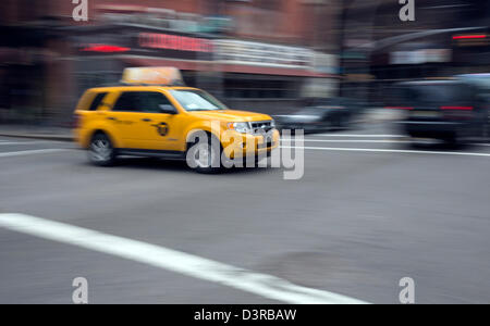 A newer hybrid model yellow taxi cab in New York City - Stock Photo