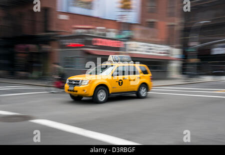 One of the newer hybrid yellow taxis in New York City - Stock Photo