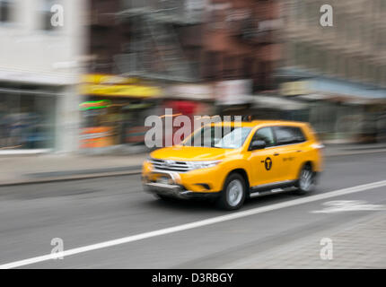 One of the newer hybrid yellow taxicabs in New York City - Stock Photo