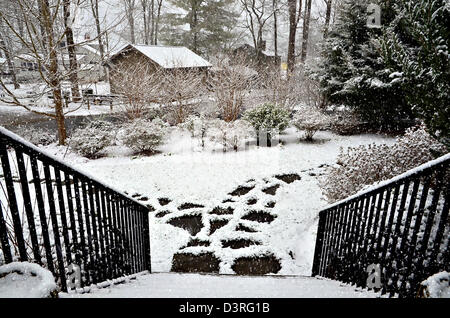 The front entry to a house on a snowy winter day. - Stock Photo
