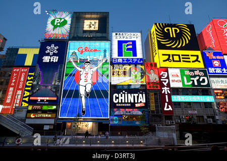 Advertising signs of so-called 'Neon Wall' in Dotonbori entertainment district of Namba, Osaka add to lively night - Stock Photo