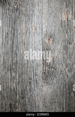 Weathered distressed rustic barn wood as textured background - Stock Photo