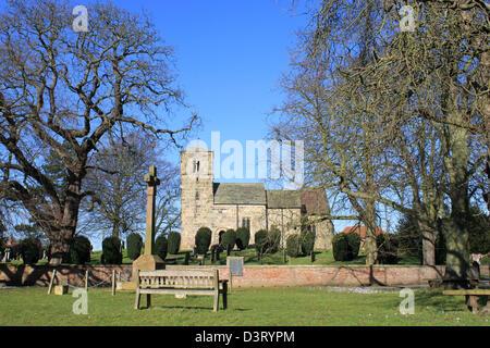 Village green and St John the Baptist C. of E. church, Kirk Hammerton, North Yorkshire, England, United Kingdom. - Stock Photo