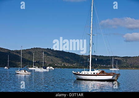 Sailing yachts in Featherbed Nature Reserve, Knysna, South Africa - Stock Photo