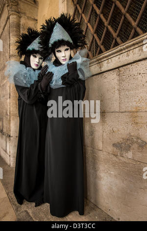 Two women dressed up for the Carnival in Venice, Veneto, Italy - Stock Photo