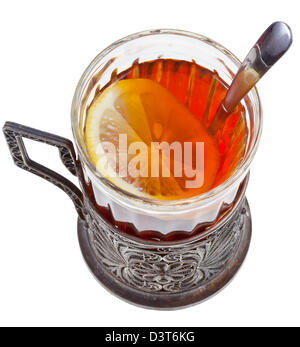black tea with lemon in vintage glass with spoon isolated on white background