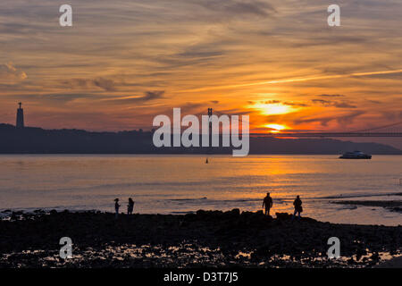 Lisbon, Portugal. View over the Tagus River towards the 25th of April bridge at sunset. - Stock Photo