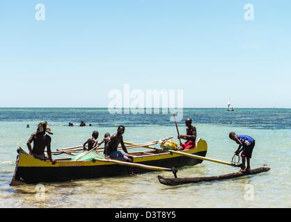 Local fishermen and traditional fishing boat Vezo fisherman village South Madagascar - Stock Photo