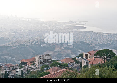 A view of the Lebanese city and port district of Beirut as seen from the town of Beit Meri in the mountains above. - Stock Photo