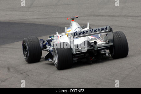 German Formula One pilot Nick Heidfeld of BMW Sauber is pictured during the third practice session at the Interlagos - Stock Photo