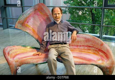 53-year-old Swiss furniture designer Yves Boucard sits on the bench 'Trifolia', which he himself conceptualized, - Stock Photo