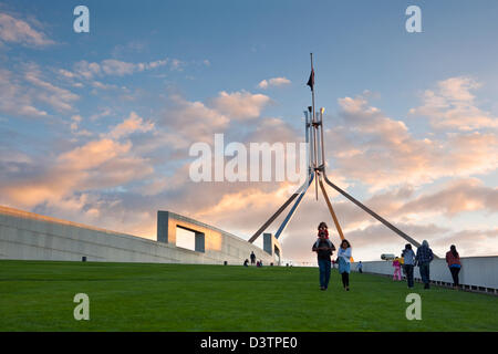 Family on rooftop lawn of Parliament House at dusk. Canberra, Australian Capital Territory (ACT), Australia - Stock Photo