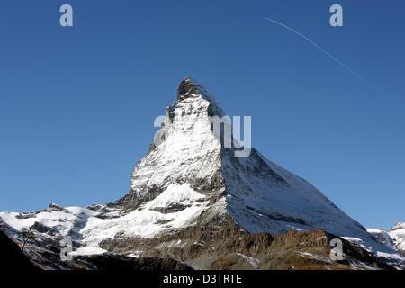 The photo shows the snow covered summit of the Matterhorn mountain above Zermatt in the Swisss canton Wallis, Switzerland, - Stock Photo