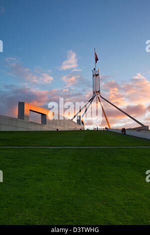 The rooftop lawn and flagpole of Parliament House at dusk. Canberra, Australian Capital Territory (ACT), Australia - Stock Photo